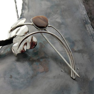 Brooch with goat horn
